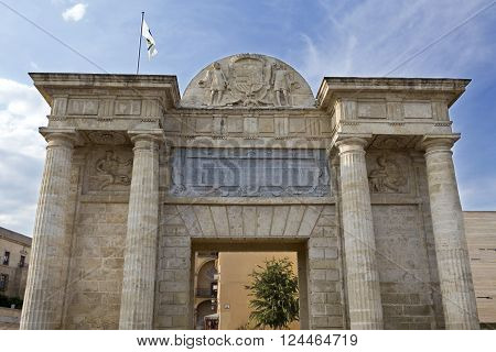 Detail of the Puerta del Puente a Renaissance gate with a central square passage sided by two couples of Doric columns surmounted by a Classic-style entablature in Córdoba Spain