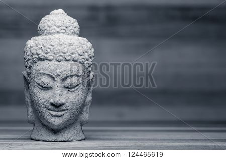Image of a Buddha head in black and white