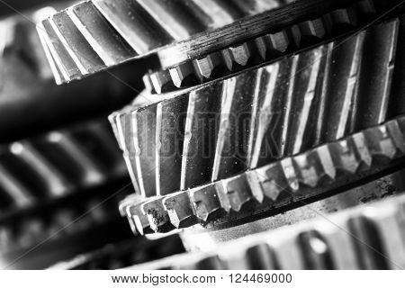 Gears, grunge cogwheels, real engine elements close-up. Heavy industry, concepts of teamwork, construction, connect.