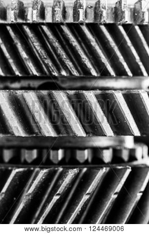 Gears, grunge cogwheels, real engine elements close-up background. Heavy industry, concepts of teamwork, construction, connect.