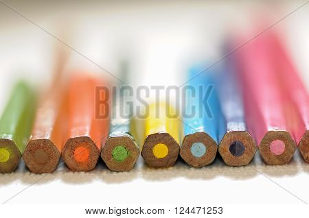 Colorful and funny arrangement of a set of pencils and ink pots.