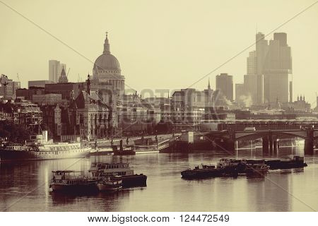 London cityscape with urban buildings over Thames River