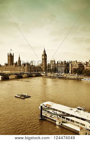 London Westminster with Big Ben bridge and boat.