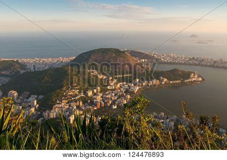 A photo of a sunset over the Lagoa Rodrigo de Freitas in Rio de Janeiro, Brazil. View from Corcovado is spectacular and shows Rio's amazing, wondrous topography. (Corcovado is Christ the Redeemer mountain).