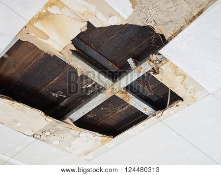 Ceiling panels damaged  huge hole in roof from rainwater leakage.Water damaged ceiling .