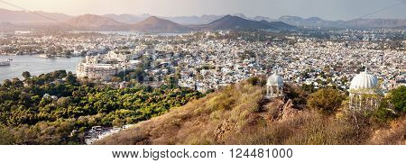Lake Pichola with City Palace panoramic view from the hill in Udaipur Rajasthan India