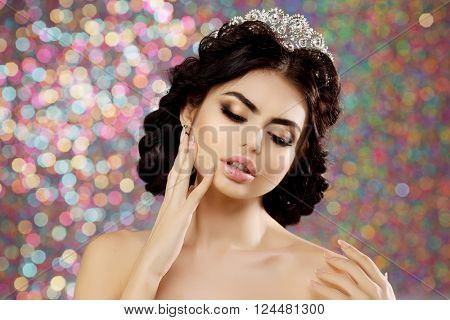 Woman in lux dress crown, queen princess lights party background Luxury girl Long shiny healthy volume hair Waves Curls Updo Hairstyle. Salon Fashion model luxurious vintage interior Jewelry Earrings
