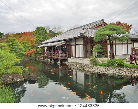 HYOGO, JAPAN - NOVEMBER 19, 2015: Unidentified tourists on the wooden terrace in Koko-en Garden in Himeji, Hyogo Prefecture, Japan. Koko-en Garden is a Japanese garden located next to Himeji Castle.