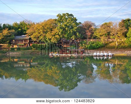 Pedal duck boats and restaurant on the side of the Asahi river, Okayama Korakuen in Okayama, Japan.