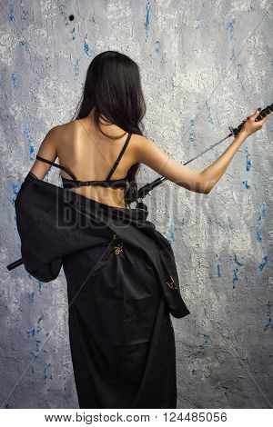 Beautiful Asian Girl In Kimono With A Katana