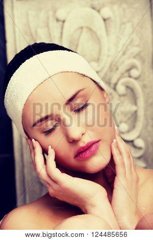 Bathing woman relaxing in bath.