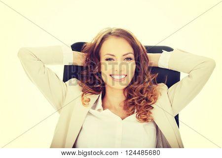 Businesswoman relaxing in office.