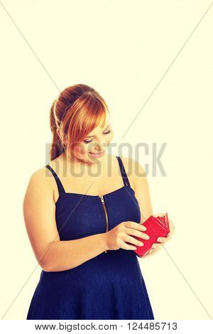 Overweight woman holding a wallet