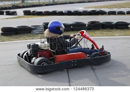 GOMEL BELARUS - MARCH 8 2010: Amateur competitions in races on karting track. organized recreation on the 8th of March