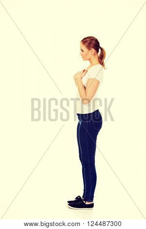 Side view of worried and sad young woman