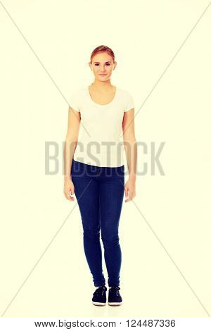 Young smiling blonde woman in white t-shirt