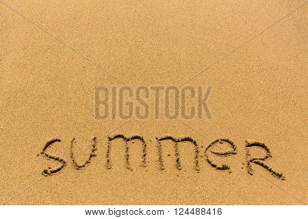 Summer - drawn on the sand of a sea beach.