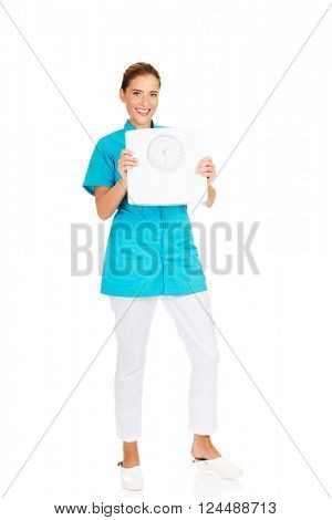 Young doctor or nurse holding weight