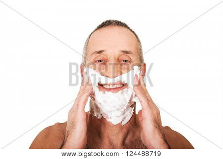 Portrait of a man applying shaving foam