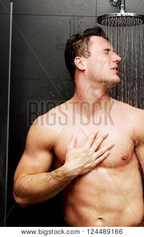 Handsome man at the shower.