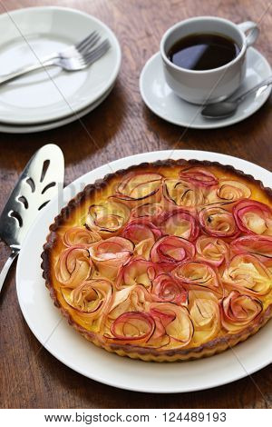 apple rose tart and cup of coffee