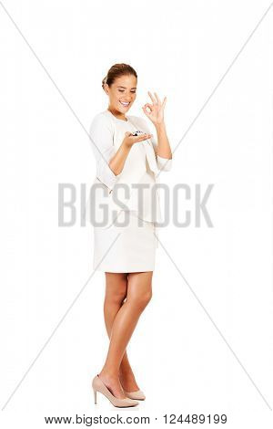 Young businesswoman holding a toy car