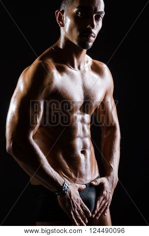 Ripped muscular man in sports concept
