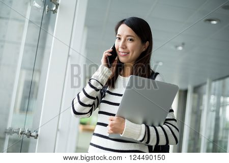 Young woman with backpack and laptop comuter