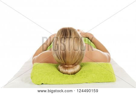 Young woman lying on massage table.