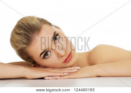 Young sad woman based on table.