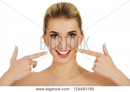 Woman showing her white teeth.