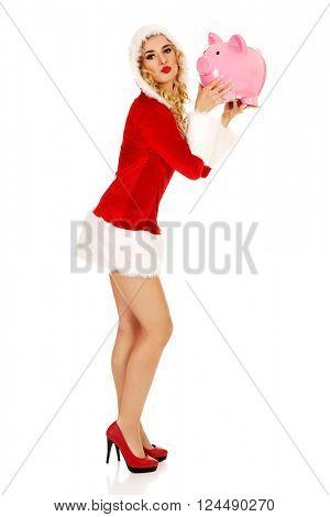 Santa woman holding a piggy bank