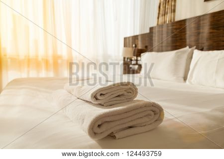 Pile Of Towels On The Bed