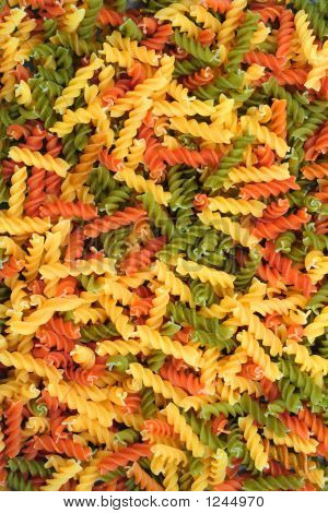 top view of colorful twisted pasta pieces poster