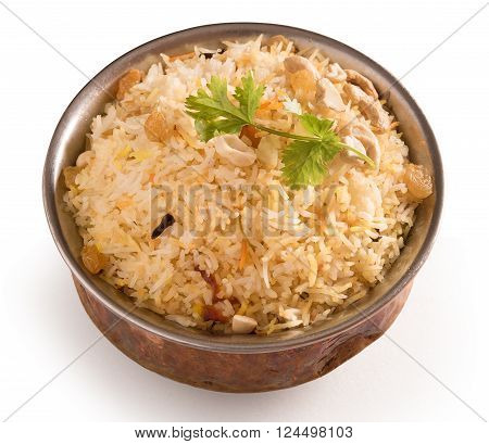 Yummy delicious biryani in a round brass bowl isolated on white background