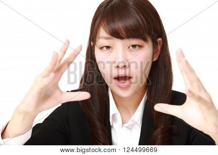 portrait of  young Japanese businesswoman with supernatural power