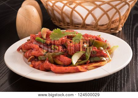 spicy Gobi Manchurian in a white plate