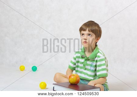 A Boy Looks Unsatisfied To Learn Something