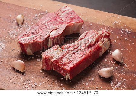 Salty Jerked Beef Steak over a wooden table