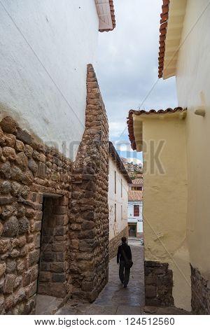 Tourist Walking In Narrow Alley Of Cusco, Peru