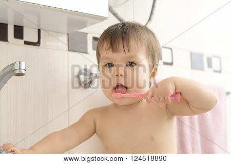 Child Cleaning Teeth In Bathroom