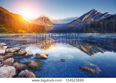 Fantastic views of the turquoise Lake Obersee under sunlight. Dramatic and picturesque scene. Location famous resort: N�¤fels, Mt. Br�¼nnelistock, Swiss Alps. Europe. Artistic picture. Beauty world.