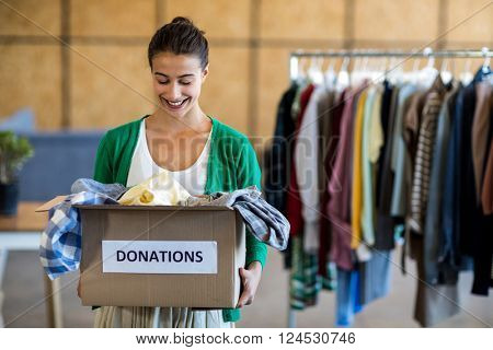 Young woman with donation box in the office