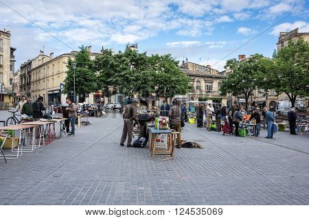 BORDEAUX FRANCE - MAY 06 2015: Flea market at Place de Meynard Bordeaux. Bordeaux is a port city on the Garonne river in southwestern France