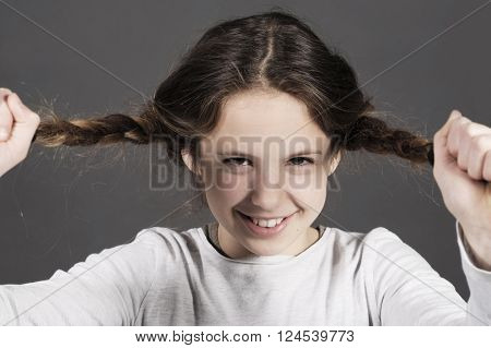cute funny girl tears her hair with a huge smile