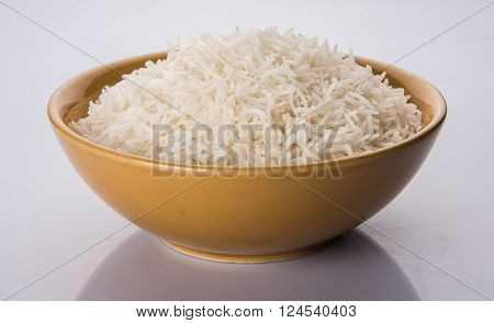 basmati rice in a brass bowl, cooked basmati rice, cooked plain rice, cooked white basmati rice, steamed basmati rice served in yellow bowl