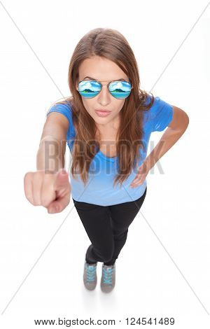 Full length woman in sunglasses with tropical resort beach palm trees reflection pointing her finger at camera or pressing virual button, over white background. High angle view