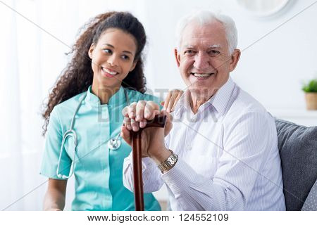 Young Pretty Nurse And Senior Man