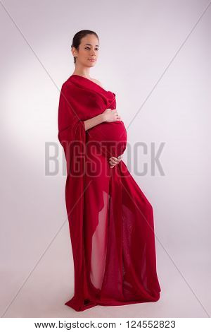 Pregnant Woman In Red Tissues