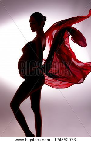 Body Contour Of Pregnant Woman In Flying Tissues